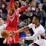 Portland Trail Blazers center Mason Plumlee (24) shoots over Houston Rockets center Dwight Howard, right, as Rockets guard James Harden (13) watches during the first half of an NBA basketball game in Portland, Ore., Wednesday, Feb. 10, 2016.