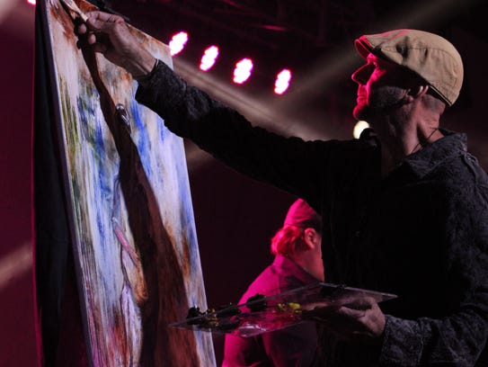 Artist Rolando Diaz painted on stage to singer Amy