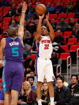 Jan 15, 2018; Detroit, MI, USA; Pistons guard Avery Bradley attempts a shot against Hornets guard Nicolas Batum during the first quarter at Little Caesars Arena.