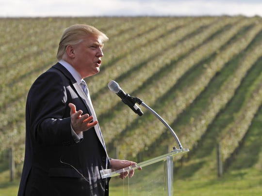 Donald Trump talks in front of rows of grapevines during a news conference at his winery in Charlottesville, on Oct. 4, 2011.