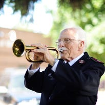 Colonel Ernest A. Miller, a retiree of the Salvation Army, was a chaplain's assistant aboard a ship in WWII during the battle of Iwo Jima. Seventy years later he still has the bugle he played taps on as he helped bury fellow servicemen at sea. Photographed Wednesday, May 20, 2015.