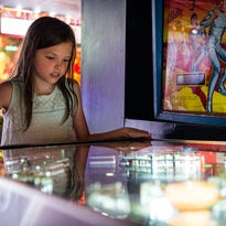 Three of the 35 pinball machines at the Asheville Pinball Museum.