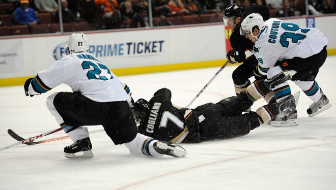Anaheim Ducks center Andrew Cogliano (7) scores after falling to the ice.