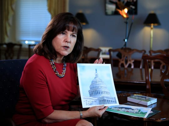 Karen Pence, wife of Vice President Mike Pence, shows her artwork during an interview with The Associated Press in her office at the Eisenhower Executive Office Building on the White House complex in Washington, Tuesday, Oct. 17, 2017. Pence is using her platform as the vice president's wife to raise awareness about art therapy, a mental health field she's been passionate about.