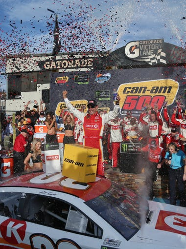 Matt Kenseth celebrates his win of the Can-Am 500 on Sunday, Nov. 12, 2017 at Phoenix Raceway in Avondale, Ariz.