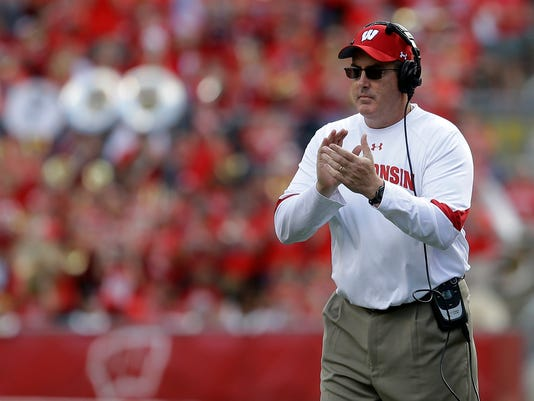 FILE - In this Sept. 10, 2016, file photo, Wisconsin head coach Paul Chryst claps from the sideline during an NCAA college football game in Madison, Wis. If No. 1 Alabama and No. 2 Ohio State are going to lose this season, this would be an excellent week to do so. The Crimson Tide taken on No. 9 Tennessee, while the Buckeyes take on No. 8 Wisconsin. (AP Photo/Aaron Gash, File)