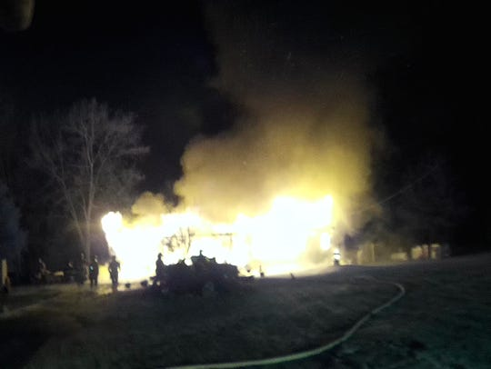 Firefighters battled a blaze that destroyed a Tyrone
