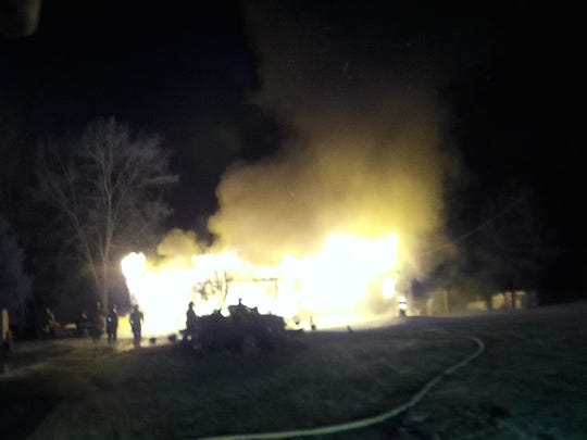 Firefighters battled a blaze that destroyed a Tyrone Township family's Fuller Drive home around 4 a.m. Saturday. The family's seven dogs died in the fire.