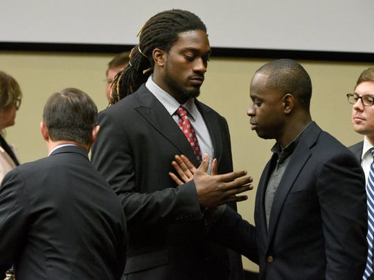 Former UT football players A.J. Johnson and Michael Williams shake hands as they leave a motions hearing in Knox County Criminal Court on Sept. 17.