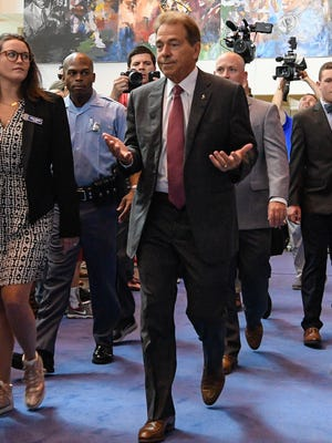 Alabama Crimson Tide head coach Nick Saban arrives on the blue carpet during SEC football media days.