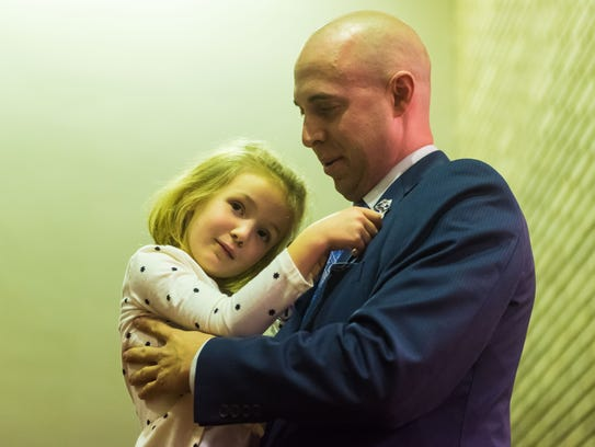 Thomas Spigelmyer is pinned by daughter Sienna Spigelmyer