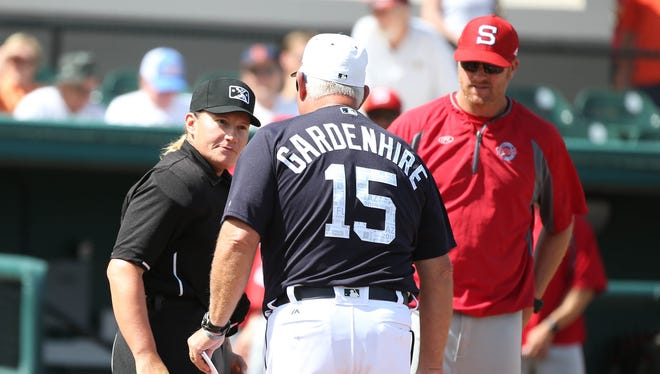 Detroit Tigers manager Ron Gardenhire, home plate umpire Jen Pawol and Florida Southern coach Lance Niekro meet before playing Thursday, Feb. 22, 2018 at Joker Marchant Stadium in Lakeland, Fla.
