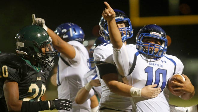 Chandler #10 Kt Tilini celebrates a turnover during the first quarter of a high school football game at Basha High in Chandler, AZ on October 24, 2014.