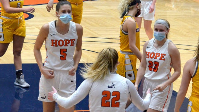 Hope College's Olivia Voskuil (left) celebrates with Lauren Newman (right) after a basket by Sydey Muller on Wednesday against Concordia Chicago at DeVos Fieldhouse.