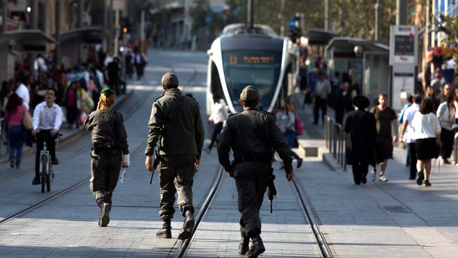 Israeli border police patrol central Jerusalem on Oct. 23. Israel increased security to try to prevent Palestinian unrest, which has escalated over the past month.