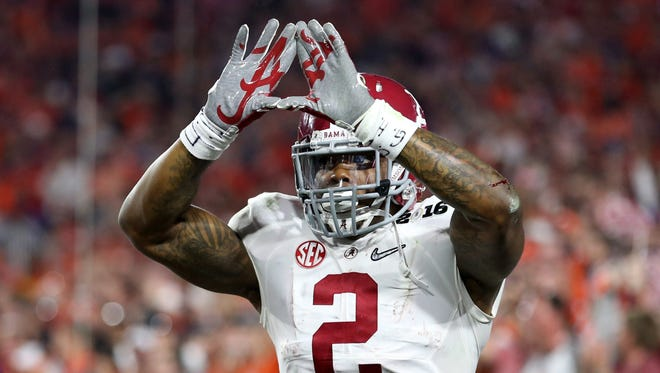 Alabama running back Derrick Henry (2) celebrates after scoring a touchdown against Clemson in the first quarter in the 2016 CFP National Championship at University of Phoenix Stadium on Jan. 11.