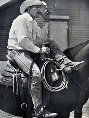 """Ranch hand Jimbo Glover at work on the Waggoner Ranch in this 1989 file photo. The 510,000-acre ranch, headquartered in Vernon, went up for sale in August 2014 and its sale is """"still in negotiation,"""" according to Bernard Uechtritz of Briggs Freeman Sotheby's International Realty in Dallas, a broker and spokesman for the effort. Interested parties had until Oct. 20 to submit a $15 million refundable deposit."""