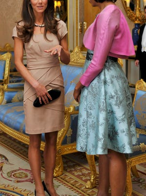 First Lady Michelle Obama talks with Duchess Kate at Buckingham Palace in May 2011.