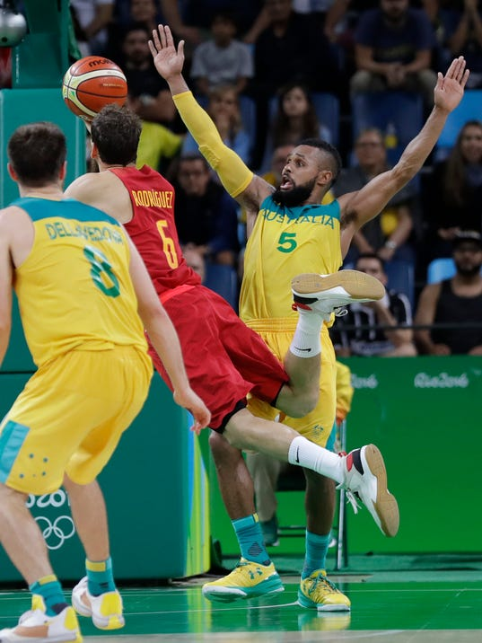 Spain's Sergio Rodriguez (6) is fouled in the final seconds by Australia's Patty Mills (5) during a men's bronze medal basketball game at the 2016 Summer Olympics in Rio de Janeiro, Brazil, Sunday, Aug. 21, 2016. (AP Photo/Eric Gay)