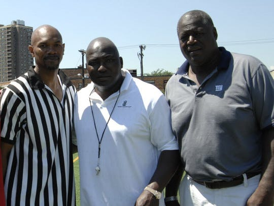Johnny Lee Davis' Football Camp at West New York Middle School in 2008: (from left) Odessa Turner, Davis and Curtis McGriff.