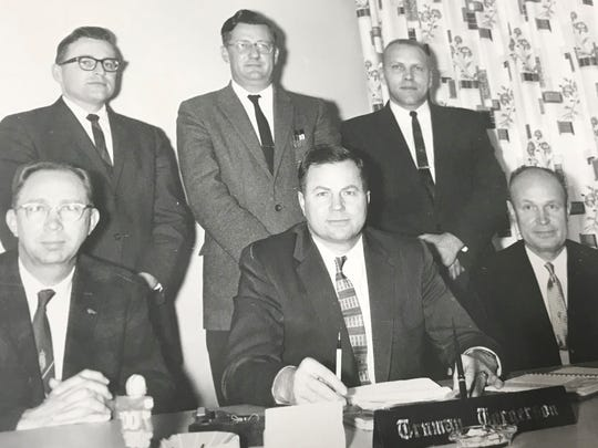 Truman Torgerson (front center) helped area farmers establish the Lake to Lake Dairy Cooperative while he served as an ag agent for Manitowoc County. Torgerson later became general manager.