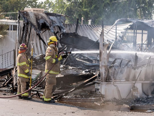 Visalia Fire Department responds to a mobile home fire south of Mooney Grove Park on Sunday, July 29, 2018.