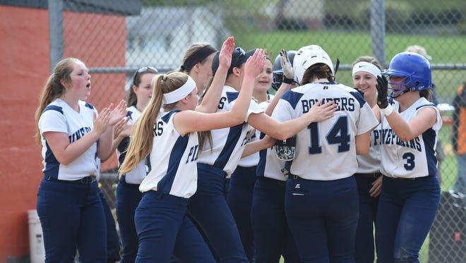 Pine Plains' softball team celebrate Cat Simmons' 2 run homer in the third inning of Thursday's MHAL championship game versus Marlboro.
