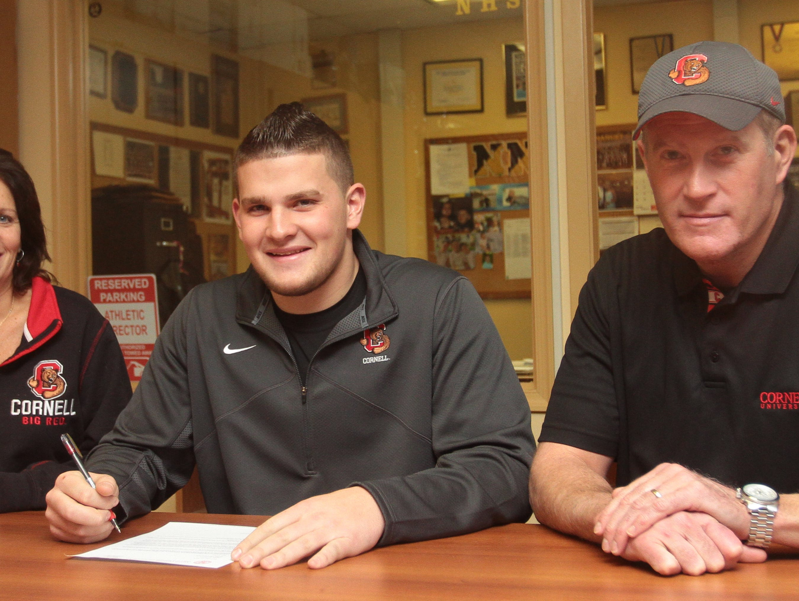 Jordan Landsman (center) with his parents Lynn (left) and Michael (right) on National Signing Day Feb. 3, 2016 at Nanuet Senior High School