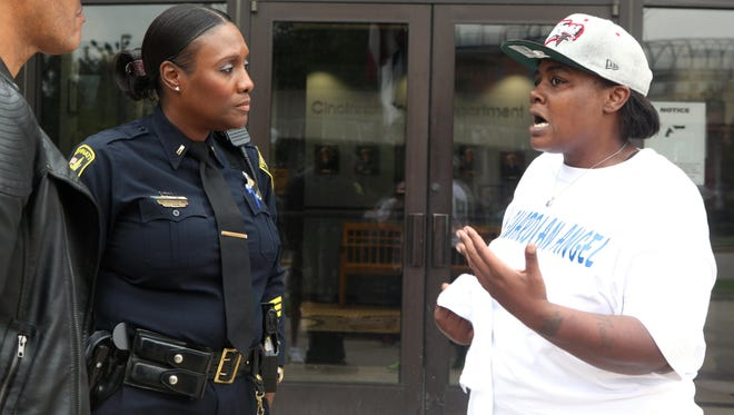 Cincinnati police Lt. Danita Pettis speaks to Erica Hicks-Woods, mother of Quandavier Hicks, on July 10 during a Black Lives Matter protest in front of Cincinnati Police District 1 Headquarters.