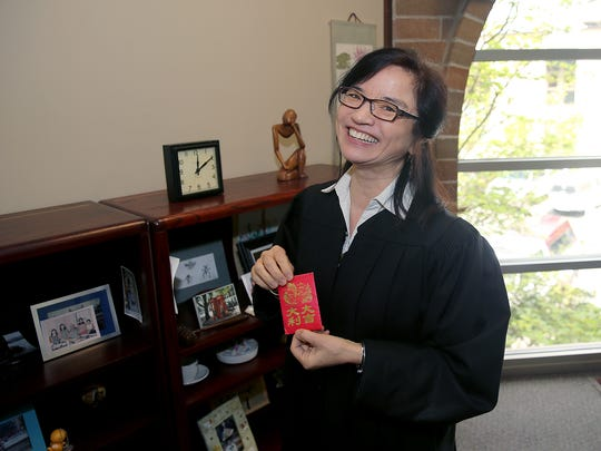 Judge Leila Mills holds an object of her mother's that holds significance.