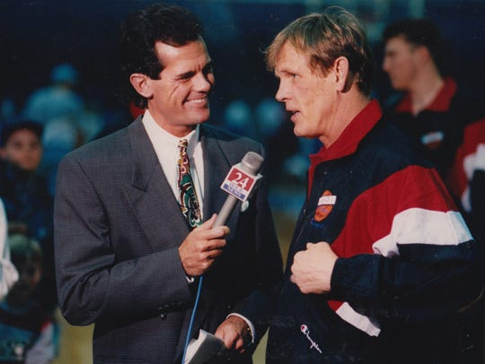 "Mark Patrick (left), WISH-TV (Channel 8) sports anchor, is shown in 1993 interviewing Nick Nolte, who starred as a college basketball coach in  ""Blue Chips."""