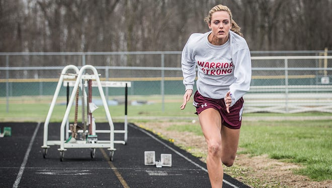 Perrie Smalley runs sprints at Wes-Del high School Wednesday afternoon.