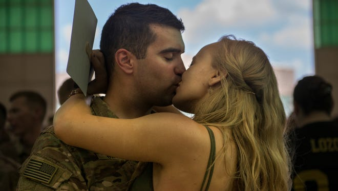 Keanu Oettinger kisses her boyfriend, John Manno, for the first time in nine months after his deployment in Afghanistan.