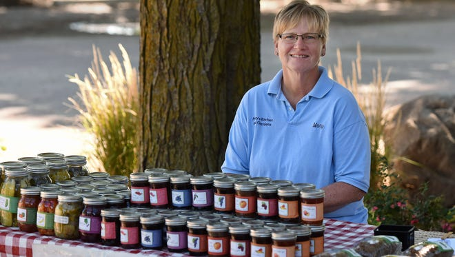 Mary Storo, owner of Mary's Kitchen and Gardens, sells her products outside of the Landscape Garden Center on a recent Saturday.