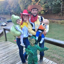 """Jesse, right, and Bridgett Pointer dressed up their family as the """"Toy Story"""" gang. Their son Levi is the army toy; Lawson is the T-Rex, and Landon is Mr. Potato Head."""