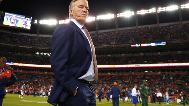 Denver Broncos Executive Vice President of Football Operations and General Manager John Elway watches his team prior to an NFL football game against the Green Bay Packers on Sunday in Denver.