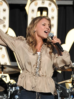 LOS ANGELES, CA - APRIL 28:  Singer Jordan Pruitt performs at the World Wish Day Celebration With Miley Cyrus at The Grove on April 28, 2010 in Los Angeles, California.  (Photo by Jordan Strauss/Invision/AP Images)