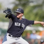 In this March 10, 2015 file photo, New York Yankees relief pitcher Jacob Lindgren throws during the eighth inning of a spring training exhibition baseball game against the Baltimore Orioles in Sarasota, Fla. Selected in the second round with the 55th overall pick, Lindgren could become just the third player from last year's draft to reach the major leagues.