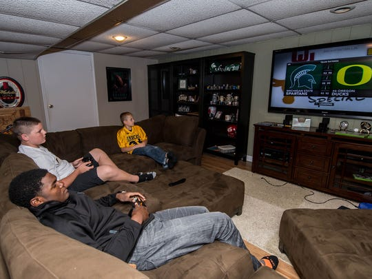 BCC senior Brandon Randle playing video games with his 'little brothers' Kyler and Kayden Granger