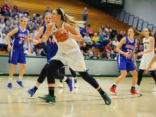Catamount forward Cassidy Derda (15) drives to the