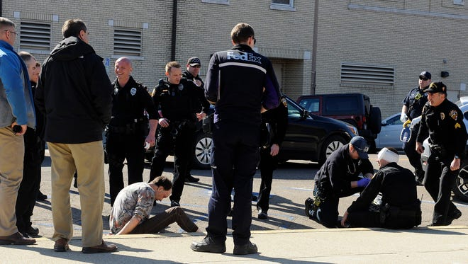 A public disturbance call Tuesday ended after a brief struggle injured one subject and a Newark Division of Police officer.