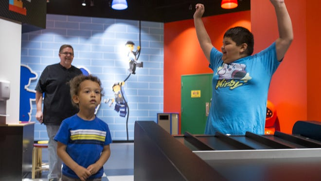 Marcus Grijalva, 8, cheers after his vehicle won a race in the Build and Test area, April 22, 2016, at Legoland Discovery Center, 5000 S. Arizona Mills Circle, Tempe