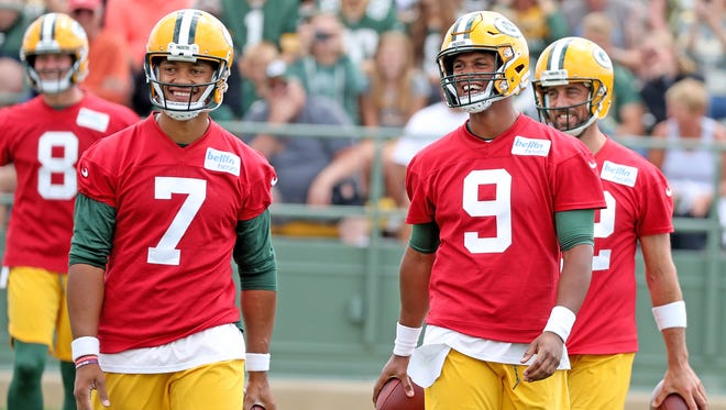 Green Bay Packers quarterbacks Brett Hundley (7), DeShone Kizer (9) and Aaron Rodgers (12) laugh after teasing the crowd during Green Bay Packers Training Camp Friday, July 27, 2018 at Ray Nitschke Field in Ashwaubenon, Wis