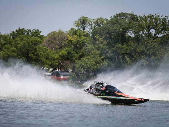 Pro boats race down the course during Showdown in San Angelo Saturday, June 23, 2018 at Lake Nasworthy.