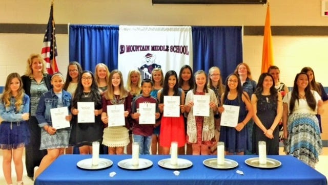The National Junior Honor Society at Red Mountain Middle School inducted eleven new members during a candle-lighting ceremony on April 13, 2016. The ceremony represents the student's dedication to the ideals of the Honor Society and their outstanding efforts to being true scholars.