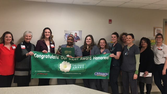 McLaren Greater Lansing nurse DeLise Robinson was honored with the DAISY Award for Extraordinary Nurses.