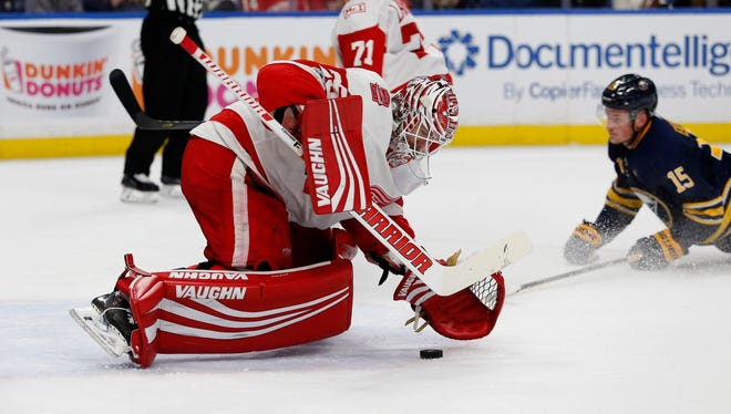 Detroit Red Wings goalie Jimmy Howard (35) covers up the puck during the second period against the Buffalo Sabres at KeyBank Center.