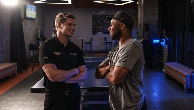 Detroit Lions wide receiver Golden Tate and IndyCar driver Josef Newgarden talk before a ping-pong battle at Drive on Monday, May 30, 2018 in downtown Detroit.