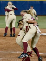 Florida State starting pitcher Meghan King celebrates