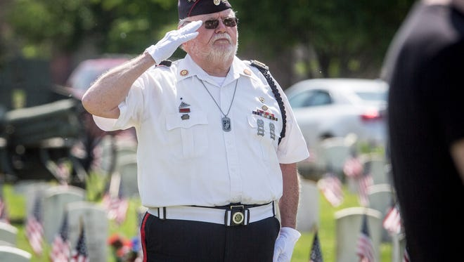 Members of the public, veterans and the Delaware County Honor Guard attend the 2016 Memorial Day service at Beech Grove Cemetery.